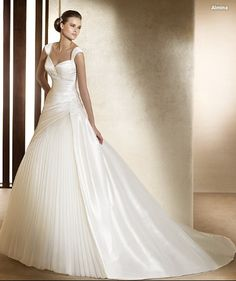 White bride wedding dress.   The following Search results list sellers of  such dresses http://shopads.whw1.com/?q=%20Pronovias%20almina%20dresses  ***** Referenced by 1 Dollar Web Hosting  (WHW1.com): WebSite Hosting - Affordable, Reliable, Fast, Easy, Advanced, and Complete.©