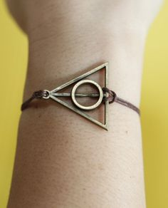 Antique bronze Harry Potter Deathly Hallows bracelet,brown wax cord bracelet,best gift for girlfriend. $1.56, via Etsy.