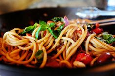 Pasta Puttanesca made with bucatini (hollow spaghetti), olives, tomatoes, red onions, fresh basil...delicious and not terrible for you!