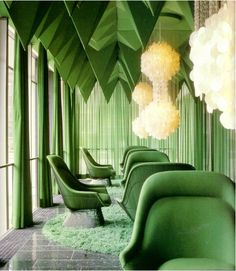 Chairs by Warren Platner and chandeliers by Verner Panton.