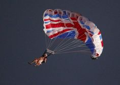 London 2012 Opening Ceremony - A performer playing the role of Britain's Queen Elizabeth parachutes from a helicopter during the opening ceremony of the London 2012 Olympic Games at the Olympic Stadium July 27, 2012. REUTERS/Fabrizio Bensch (BRITAIN - Tags: OLYMPICS SPORT)