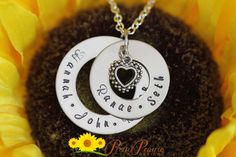 """FAMILY NECKLACE DESCRIPTION: Personalized double stainless steel ring necklace with the names of your family members by Pretty Prairie Designs.   DISC SIZES/MATERIALS: The discs are made of stainless steel and won't tarnish or fade and the outer disc is approx. 1 1/4"""" wide.  #prettyprairiedesigns https://www.etsy.com/listing/229105644"""