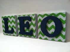 "Make each canvas a different color of chevron (light blue, orange, and light green) and add navy letters that say ""A B C."""