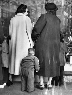 Vintage photo of a boy Christmas shopping with his mother in Downtown Detroit. Photo taken 1953