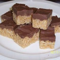 "Scotch-A-Roos: The ""Ultimate"" Rice Kirspie Treat! Double the recipe and use whole box of Rice Krispies and 1 full bag of each butterscotch and milk choc chips. Use jelly roll pan or larger. Baking Recipes, Cookie Recipes, Dessert Recipes, Rice Recipes, Yummy Recipes, Just Desserts, Delicious Desserts, Yummy Food, Rice Krispie Treats"