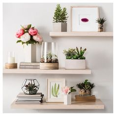 I love the greenery used in these floating shelves | Shop the look #decor #walldecor #ad