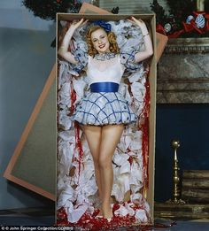 All I want for Christmas is you: Actress Anne Jeffreys pops out of a package in this 1946 photo...