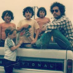 Daddy Dylan. Actually only the three in the truck are his. Not sure who the boy is in front. David Zimmerman's son maybe?