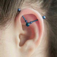 unique industrial piercing using Industrial Strength's ear orbit jewelry