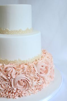 Cute rosette wedding cake | Inspiring post by Bridestory.com, everyone should read about Vendor of the Week: Guilt Desserts on http://www.bridestory.com/blog/vendor-of-the-week-guilt-desserts