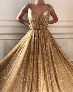 sparkly golden dress. this is actual sunshine.