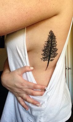 Pine tree tattoo on my side/rib cage