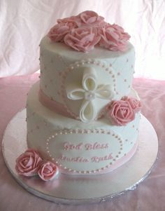 Baptism cake for baby girl. Buttercream icing, buttercream roses, fondant cross and plaques
