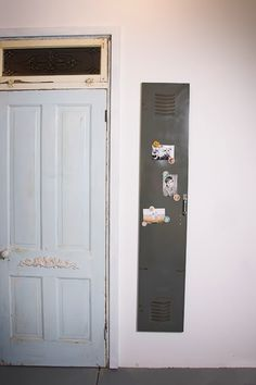 Love the door. Also the locker is a cute idea to hang pictures and magnets