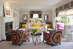 Lots of patterns and prints in this living room designed by Massucco Warner Miller (via Desire to Inspire).