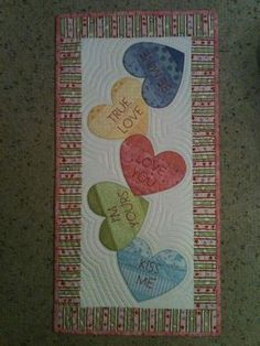 """Each quilt is appliqued and can be a wall quilt or table runner is approx. 14"""" x 28"""". This pattern has 3 great wall hangings. Table Runner And Placemats, Table Runner Pattern, Quilted Table Runners, Small Quilts, Mini Quilts, Patchwork Quilt, Hexagon Quilt, Skinny Quilts, Christmas Quilting Projects"""