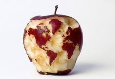 Someone has some very precise chompers. An apple a day keeps the world... _(fill in the blank)______