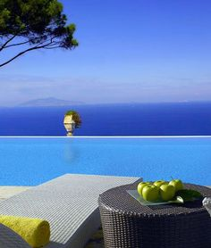 a 5 star #Luxury Hotel: Caesar Augustus Hotel in #Capri, Italy -On a cliff 1000 feet above the sea, the luxury Hotel Caesar Augustus offers one of the most spectacular vistas to be found on the isle of Capri!
