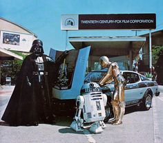 Darth Vader displaying his 1977 Toyota Celica to R2-D2 & C-3PO.