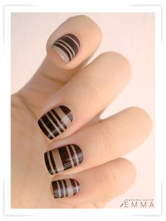 design done by using nail striping tape to help make the perfect lines with nail polish