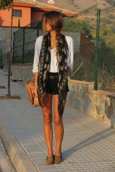 Black shorts, cheetah flats, brown belt, loose white top, patterned scarf