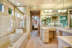 Traditional Master Bathroom with flush light, Built-in bookshelf, limestone tile floors