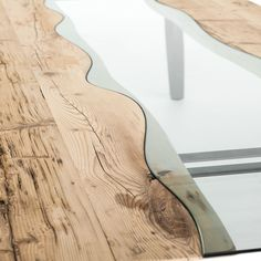 Rio Sygma is a unique modern fixed dining table by Sedit, boasting a wooden rectangular table top with a combination of extra-clear tempered glass or ecomal.
