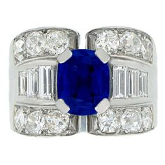 Mauboussin Sapphire And Diamond Ring | From a unique collection of vintage cocktail rings at http://www.1stdibs.com/jewelry/rings/cocktail-rings/