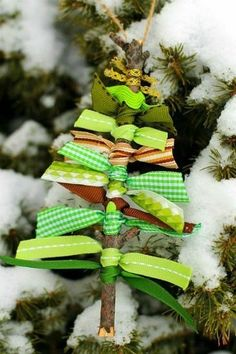 Ribbon and Twig Tree Ornament from Fire Flies and Mud Pies and 31 DIY Christmas Gift Ideas on Frugal Coupon Living.