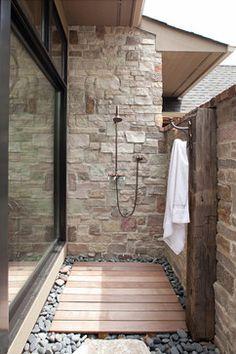 Exterior shower. Love the deck floor and pebble border! John Kraemer & Sons's Design