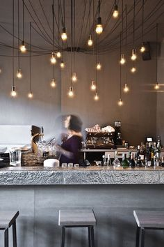 Modern, hanging lights, bartender.