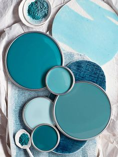 Teal Blue Paint Colors (from top: Moroccan Blue by True Value, New World by Dutchboy, Teal Zeal by Olympic, Tidewater by Sherwin-Williams, and Gypsy Teal by Valspar)