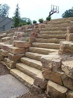 Natural stone steps and retaining wall. By Signature Outdoor Concepts