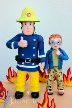 A Fireman Sam cake for his fan, little Lucas. The figures are gumpaste, as are the flames. The ladder is polymer clay for durability (and I wasn't sure about the limitations of sugar! The customers only request was that she wanted Norman. Fireman Sam Birthday Cake, Thomas Birthday Cakes, Fireman Sam Cake, Fireman Party, Firefighter Birthday, Firefighter Gifts, Little Boy Cakes, Cakes For Boys, Police Car Cakes