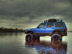 Lifted Blue XJ Jeep. I want another Cherokee! Even stock, they are great offroad/camping/hunting rigs...
