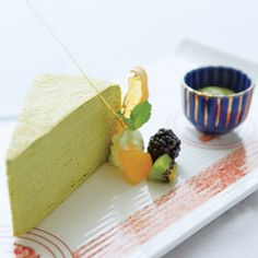 A wedge consisting of layers of green tea crepes, served with fresh fruit at MEGU.