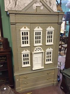 Childs wardrobe in the form of a Georgian dolls house.