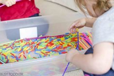 Check out this THREADING STATION! An awesome quiet time toddler activity that's perfect for indoor days. An easy indoor activity for toddlers that also doubles as sensory and fine motor skills play! Indoor Activities For Toddlers, Quiet Time Activities, Toddler Learning Activities, Infant Activities, Preschool Activities, Preschool Prep, Toddler Fun, Early Childhood, Threading