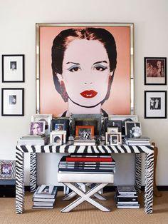Andy Warhol's Lithograph of Fashion Designer Carolina Herrera hangs in her office.
