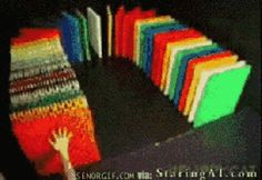Knocking down dominoes, made out of dominoes.  Gif.