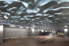 Paul Raff Studio have recently completed Wavelengths, the installation of 100 sculptural fibreglass panels, to the ceiling of the parking area for the Market Wharf condo building, in Toronto, Canada.