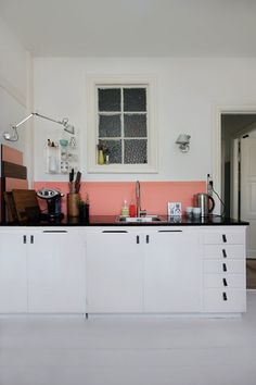 Anne Mette Skodbor, Copenhagen home, painted coral backsplash in kitchen  | Remodelista >> wall lights