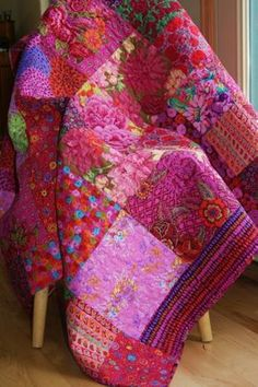 Wow, this quilt is steaming HOT! These gorgeous, pink and red fabrics from designer Kaffe Fassett come together in this beautiful, handmade throw sized quilt. It measures 54 x 68. Toss it over a chair or couch, or fold it along the bottom of a bed...however it is used, it will be