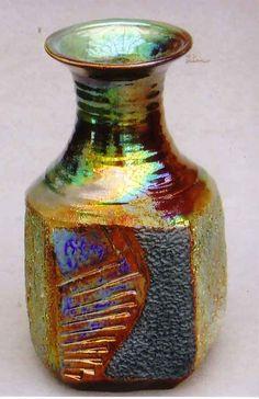 M.Wein 5 sided Raku vase twice fired and water tight.