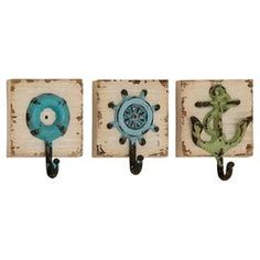 """Add a nautical touch to your entryway or master suite with this ship-themed wall hook, featuring a distressed finish for weathered appeal.  Product: Set of 3 all hooksConstruction Material: Iron and woodColor: Beige, blue and greenFeatures: One hook eachDimensions: 7"""" H x 5"""" W x 3"""" D"""
