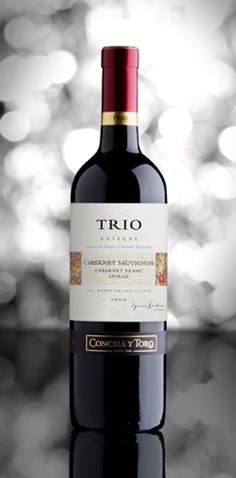 Trio is a premium blend of three different grapes. It represents the complexity and elegance of great blending, at a more affordable price. Red Wine, Alcoholic Drinks, Bottle, Glass, Drinkware, Alcoholic Beverages, Flask, Liquor, Jars