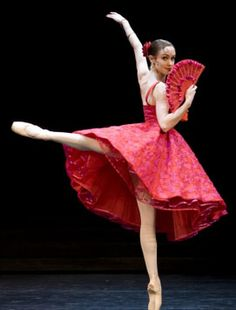 Katie Hurst-Saxton dances with a red fan to match her stunning Spanish dress in Don Quixote.