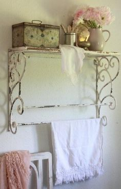 Wrought iron shelf. I like this, but I would add something on the wall between the shelf and the bars - a picture? some floral plates? And I would make sure that the towel there was unwrinkled and more decorative.