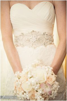 Love the bodice and bouquet... Not sure about the skirt