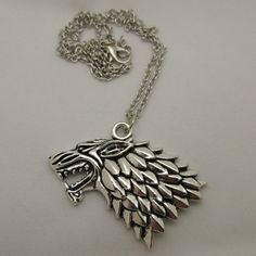 Game of Thrones House Stark Direwolf Sigil Antique Silver Pendant... (€13) ❤ liked on Polyvore featuring jewelry, necklaces, antique silver jewellery, pendant necklaces, antique silver necklace and antique silver jewelry